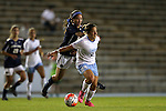 22 October 2015: North Carolina's Paige Nielsen (24) and Notre Dame's Sandra Yu (behind). The University of North Carolina Tar Heels hosted the Notre Dame University Fighting Irish at Fetzer Field in Chapel Hill, NC in a 2015 NCAA Division I Women's Soccer game. UNC won the game 2-1.