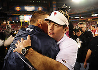 Jan. 1, 2011; Glendale, AZ, USA; Oklahoma Sooners head coach Bob Stoops (right) embraces Connecticut Huskies head coach Randy Edsall following the game in the 2011 Fiesta Bowl at University of Phoenix Stadium. The Sooners defeated the Huskies 48-20. Mandatory Credit: Mark J. Rebilas-