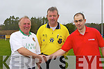 Put it there: Captains Ger Healy and Jim Sheehan shake hands under the watchful eye of ref John Roche at the charity soccer match between Moss Harnetts and Killarney Road Chancers on Sunday.