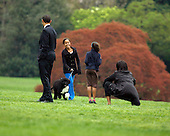 Washington, D.C. - April 14, 2009 -- The First Family shows off their new dog, Bo, on the South Lawn of the White House on Tuesday, April 14, 2009.  From left to right: United States President Barack Obama, Bo, Malia Obama, Sasha Obama, and first lady Michelle Obama..Credit: CNP