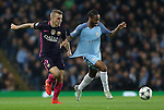 Lucas Digne of Barcelona tussles with Raheem Sterling of Manchester City during the Champions League Group C match at the Etihad Stadium, Manchester. Picture date: November 1st, 2016. Pic Simon Bellis/Sportimage
