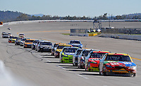Nov. 1, 2009; Talladega, AL, USA; NASCAR Sprint Cup Series driver Kyle Busch leads a pack of cars single file down the backstretch during the Amp Energy 500 at the Talladega Superspeedway. Mandatory Credit: Mark J. Rebilas-