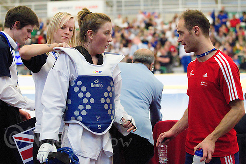 05 MAY 2012 - MANCHESTER, GBR - Jade Jones (GBR) of Great Britain (in blue) talks with her national team coach Paul Green after her  women's -57kg category quarter final win over Deborah Louz of The Netherlands at the 2012 European Taekwondo Championships at Sportcity in Manchester, Great Britain .(PHOTO (C) 2012 NIGEL FARROW)