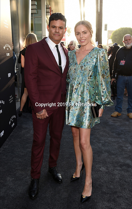 "LOS ANGELES - AUGUST 27: Co-Creator/Executive Producer/Writer/Director Elgin James and Elizabeth James attend the season two red carpet premiere of FX's ""Mayans M.C"" at the ArcLight Dome on August 27, 2019 in Los Angeles, California. (Photo by Frank Micelotta/FX/PictureGroup)"