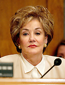 """United States Senator Elizabeth H. Dole (Republican of North Carolina) listens to Federal Reserve Chairman Alan Greenspan's testimony before the United States Senate Banking, Housing and Urban Affairs Committee on """"Regulatory Reform of the Government Sponsored Enterprises (GSE) in Washington, D.C. on April 6, 2005.  .Credit: Ron Sachs / CNP"""