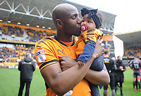 Wolverhampton Wanderers' Benik Afobe kisses his daughter at full time <br /> <br /> Photographer Ashley Crowden/CameraSport<br /> <br /> The EFL Sky Bet Championship - Wolverhampton Wanderers v Birmingham City - Sunday 15th April 2018 - Molineux - Wolverhampton<br /> <br /> World Copyright &copy; 2018 CameraSport. All rights reserved. 43 Linden Ave. Countesthorpe. Leicester. England. LE8 5PG - Tel: +44 (0) 116 277 4147 - admin@camerasport.com - www.camerasport.com