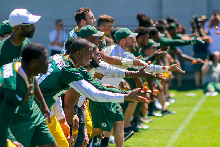 Green Bay Packers players participate in an egg toss following their final minicamp practice on June 15, 2017 at Clarke Hinkle Field in Green Bay, Wisconsin.  (Brad Krause/Krause Sports Photography)