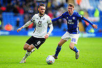 Matt Grimes of Swansea City battles with Gavin Whyte of Cardiff City in action during the Sky Bet Championship match between Cardiff City and Swansea City at the Cardiff City Stadium in Cardiff, Wales, UK. Sunday 12 January 2020