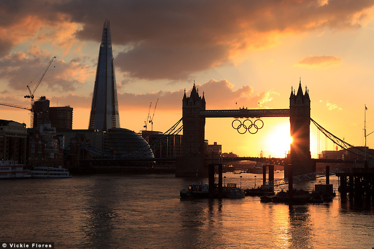 Tower Bridge sunset behind the Olympic rings and the London Shard on the River Thames in London - 19 August 2012