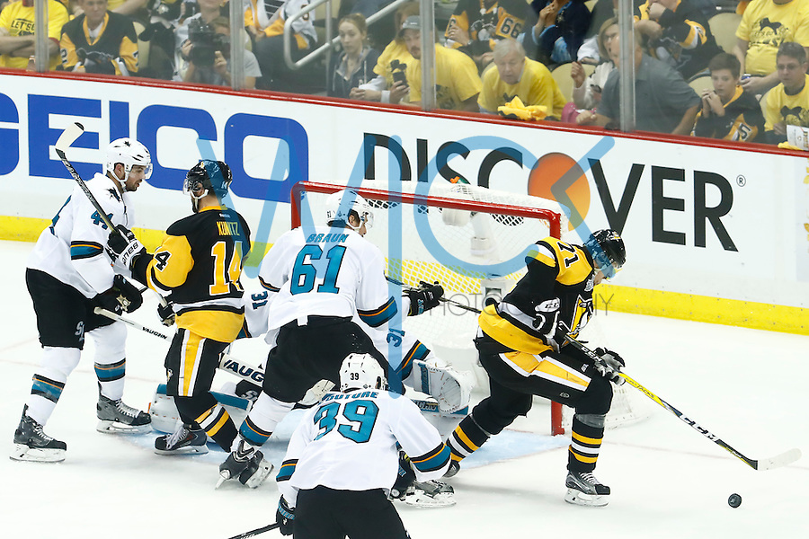 Evgeni Malkin #71 of the Pittsburgh Penguins attempts to corral the puck in front of Martin Jones #31 of the San Jose Sharks in the third period during game five of the Stanley Cup Final at Consol Energy Center in Pittsburgh, Pennsylvania on June 9, 2016. (Photo by Jared Wickerham / DKPS)
