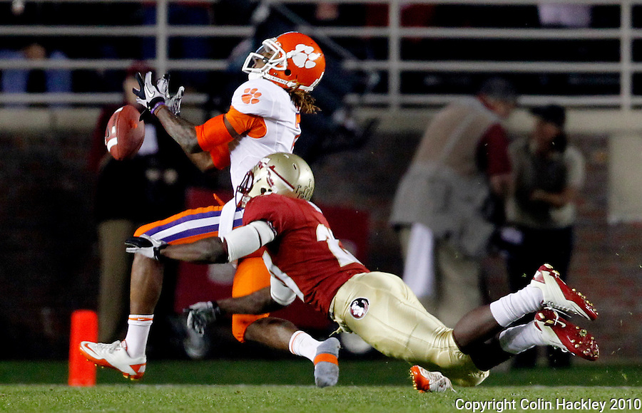 TALLAHASSEE, FL 11/13/10-FSU-CLEMSON FB10 CH-Florida State's Xavier Rhodes knocks a pass (and possibly a shoe) loose from  Clemson's Bryce McNeal during first half action Saturday at Doak Campbell Stadium in Tallahassee. .COLIN HACKLEY PHOTO