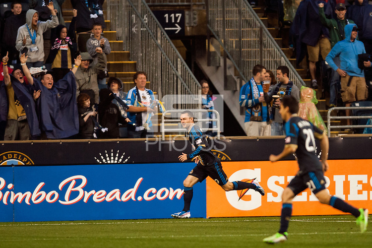 Jack McInerney (9) of the Philadelphia Union celebrates scoring during the first half against the Chicago Fire during a Major League Soccer (MLS) match at PPL Park in Chester, PA, on May 18, 2013.