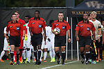 10 September 2016: Match Officials. From left: Assistant Referee Aaron Gallagher, Fourth Official Justin Howard, Referee Chris Penso, and Assistant Referee Larry Stroud. The Wake Forest University Demon Deacons hosted the University of Virginia Cavaliers in a 2016 NCAA Division I Men's Soccer match. Wake Forest won the game 1-0 in sudden death overtime.