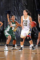 11 November 2011:  FIU's Fanni Hutlassa (10) handles the ball while being defended by Jacksonville's Jade Cargill (5) in the first half as the FIU Golden Panthers defeated the Jacksonville University Dolphins, 63-37, at the U.S. Century Bank Arena in Miami, Florida.