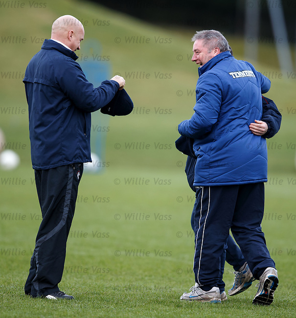 Kenny McDowall sorts out Ally McCoist's hat