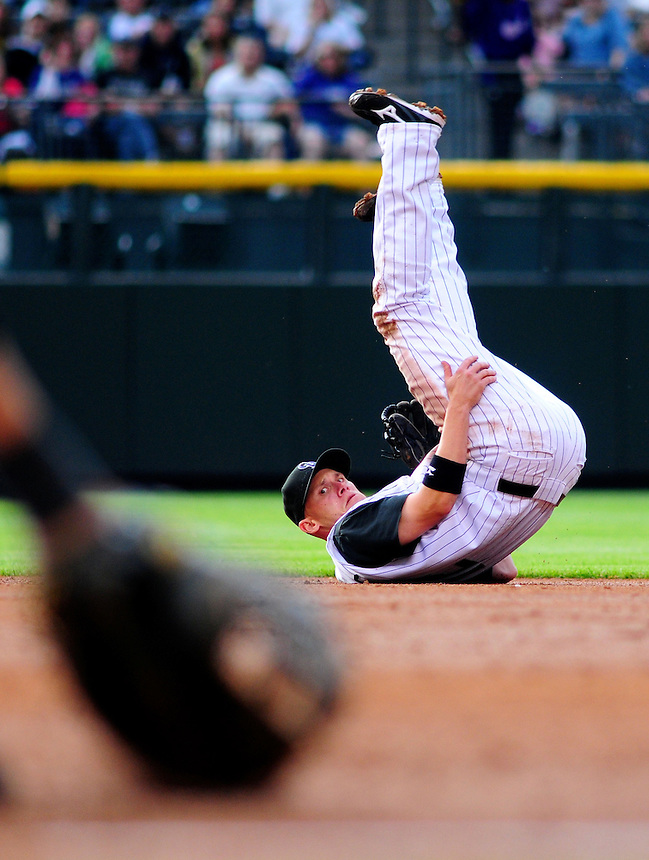 May 30, 2009: Rockies 2nd baseman Clint Barmes watches to see whether the runner is out after making a spectacular throw during a game between the San Diego Padres and the Colorado Rockies at Coors Field in Denver, Colorado. The Rockies beat the Padres 8-7.