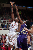 STANFORD, CA - February 12, 2011: Chiney Ogwumike of the Stanford Cardinal women's basketball team fights for the rebound during Stanford's 62-52 win over Washington at Maples Pavilion.