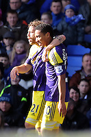 Pictured: Jonathan de Guzman of Swansea (R) with team mate Jose Canas (L) celebrating his equaliser making the score 1-1. Sunday 16 February 2014<br />