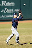 Left fielder Tyler Uphouse #25 of the Shippensburg Red Raiders tracks a fly ball against the Catawba Indians at Newman Park on February 12, 2011 in Salisbury, North Carolina.  Photo by Brian Westerholt / Four Seam Images