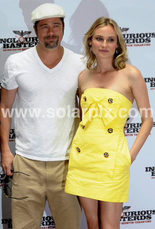 **ALL ROUND PICTURES FROM SOLARPIX.COM**.**SYNDICATION RIGHTS FOR UK AND SPAIN ONLY**.the premiere of 'Inglourious Basterds' in Berlin, Germany. 28 July 2009..This pic: Brad Pitt and Diane Kruger..JOB REF: 9627 CPR (Kappeler) DATE: 28_07_2009.**MUST CREDIT SOLARPIX.COM OR DOUBLE FEE WILL BE CHARGED**.**MUST NOTIFY SOLARPIX OF ONLINE USAGE**.**CALL US ON: +34 952 811 768 or LOW RATE FROM UK 0844 617 7637**