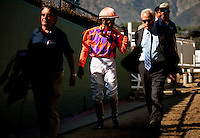 Jockey, Rafael Bejarano and trainer Jerry Hollendorfer talk about the trip on Killer Graces in the Provedincia Stakes at Santa Anita Park in Arcadia California on April 7, 2012.