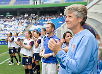 USWNT head coach Pia Sundhage watches her team during the national anthem before the finals of the Peace Queen Cup.  The USWNT defeated Canada, 1-0, at Suwon World Cup Stadium in Suwon, South Korea.