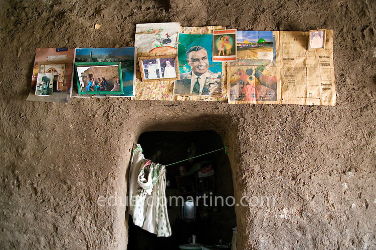 Detail of pictures on Fatma Mohamed's wall, including relatives, a foreign friend and Anwar Sadat..Qurna, Luxor, Egypt..Photo: Eduardo Martino