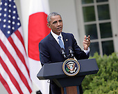 US President Barack Obama participates in a news briefing with Japan's Prime Minister Shinzo Abe at The White House in Washington DC for a State Visit, April 28, 2015. Credit: Chris Kleponis / CNP