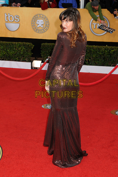 PAZ DE LA HUERTA.17th Annual Screen Actors Guild Awards held at The Shrine Auditorium, Los Angeles, California, USA..January 30th, 2011.SAG arrivals  full length bronze metallic brown dress long sleeves back behind rear looking over shoulder .CAP/ADM/BP.©Byron Purvis/AdMedia/Capital Pictures.