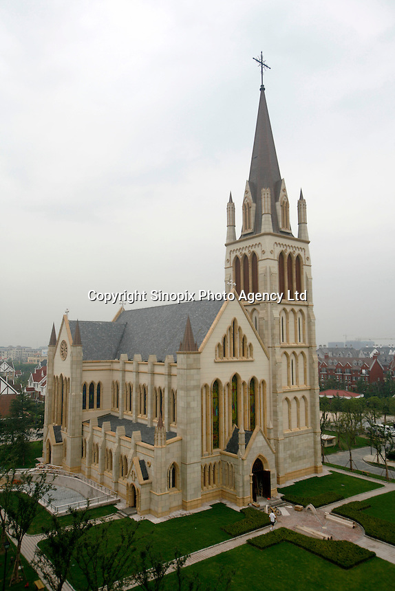 "A mock church stands tall in Thames Town, in Shanghai, China. Thames Town is one of several satellite townships that Shanghai is building in hopes of luring residents away from the city centre, and claims to allow people to ""taste authentic British style of small town""..21 Jul 2006"