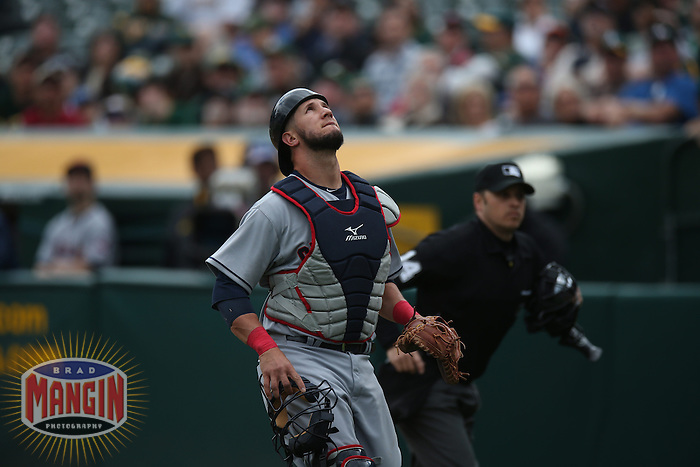 OAKLAND, CA - APRIL 2:  Yan Gomes #10 of the Cleveland Indians works against the Oakland Athletics during the game at O.co Coliseum on Wednesday, April 2, 2014 in Oakland, California. Photo by Brad Mangin