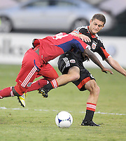 D.C. United defender Chris Korb (22) goes against Chicago Fire midfielder Patrick Nyarko (14) D.C. United defeated The Chicago Fire 4-2 at RFK Stadium, Wednesday August 22, 2012.