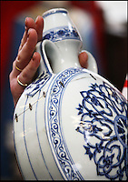 BNPS.co.uk (01202 558833).Pic: Dukes/BNPS..Over the moon...flask...Stapled together...but still worth £120,000...A broken Chinese vase that was delivered by its elderly owner to an auction house in a battered cardboard box has sold for £120,000...The man, aged in his 80s, had inherited the 11 inch moonflask vase from a relative many years ago and had no idea of its worth...The top part had once broken off and had been very crudely stitched back together using large metal staples, a technique last used by ceramic specialists in the 1960s...Although experts suspected the piece dated back to Imperiel China, the ugly 11ins-long scar led to them to put a 2,000 pounds pre-sale estimate on it...But scores of Chinese collectors lined up to bid on the blue and white vase when it came up for auction, reaffirming the belief the piece dated back to the 15th century...It was finally bought for 119,500 pounds. Had it not had the hefty crack running through it, it is likely the Ming vase would have fetched one million pounds..
