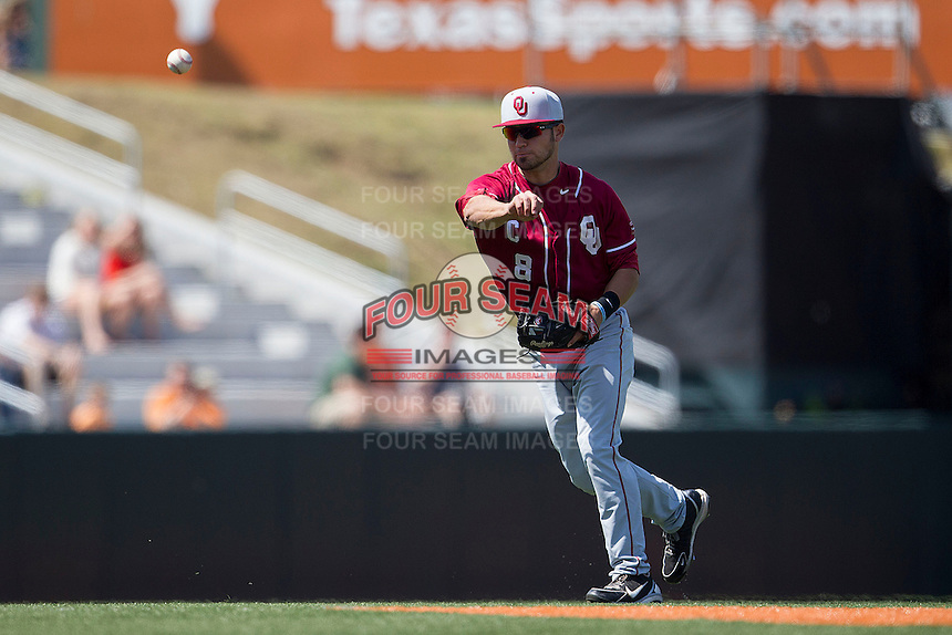 Oklahoma Sooners shortstop Jack Mayfield #8 makes a throw to first base against the Texas Longhorns in the NCAA baseball game on April 6, 2013 at UFCU DischFalk Field in Austin, Texas. The Longhorns defeated the rival Sooners 1-0. (Andrew Woolley/Four Seam Images).