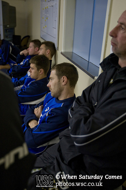 Rochdale v Tranmere Rovers preparations, 31/12/2010. Prenton Park, League One. Tranmere Rovers players Ian Thomas-Moore (centre) and Aaron Cresswell watching and listening to coach David Low's briefing the first team squad at the club's Prenton Park ground, as the club prepare for the following day's Npower League 1 fixture away to Rochdale. It was the first league fixture between the teams since March 1989. Rochdale won this latest encounter by three goals to two watched by a crowd of 5,500. Photo by Colin McPherson.