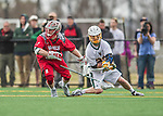 18 April 2015: University of Hartford Hawk Midfielder Brendan Gates, a Freshman from Ashland, MA, has his stick hit away by University of Vermont Catamount Long Stick Midfielder Graham Bocklet, a Freshman from Waccabuc, NY, during action at Virtue Field in Burlington, Vermont. The Cats defeated the Hawks 14-11 in the final home game of the 2015 season. Mandatory Credit: Ed Wolfstein Photo *** RAW (NEF) Image File Available ***