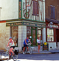 Chablis village: a wine shop belonging to Jean Marc Brocard wine maker, cycling tourists