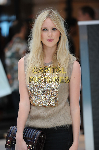 Diana Vickers.'Total Recall' - UK Film Premiere, Vue Cinema, Leicester Square, London, England..August 16th, 2012.half length black jeans denim mohair beige gold sleeveless top clutch bag sequins sequined .CAP/CAS.©Bob Cass/Capital Pictures.