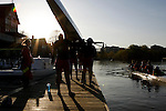 Philadelphia, Pennsylvania - Members of the University of Pennsylvania Women's Crew team prepare to place their skull in the water at the beginning of practice in the early morning hours on the Schuylkill River in Philadelphia, Pennsylvania.