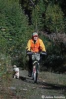 Hunter riding bicycle