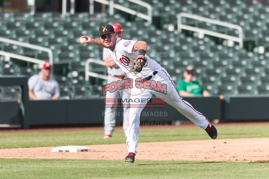 Salt River Rafters third baseman Jake Noll (17), of the Washington Nationals organization, makes a running throw to first base during an Arizona Fall League game against the Surprise Saguaros at Salt River Fields at Talking Stick on October 23, 2018 in Scottsdale, Arizona. Salt River defeated Surprise 7-5 . (Zachary Lucy/Four Seam Images)