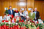 Jack Shanahan (Kerry Hospice), Betty Walsh, Renee McCarthy, Bertha O'Sullivan, Kathleen Reidy and David Gainey (Castleisland Bridge Club) at the cheque presentation to Kerry Hospice and Cork Kerry Cancer Link Bus at the Magical Christmas Floral display in the River Island Hotel on Tuesday night .