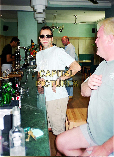 JOHNNY LEE MILLER.bar, drinks, smiling, grinning, shades, sunglasses, half length, half-length, paparazzi picture.www.capitalpictures.com.sales@capitalpictures.com.© Capital Pictures