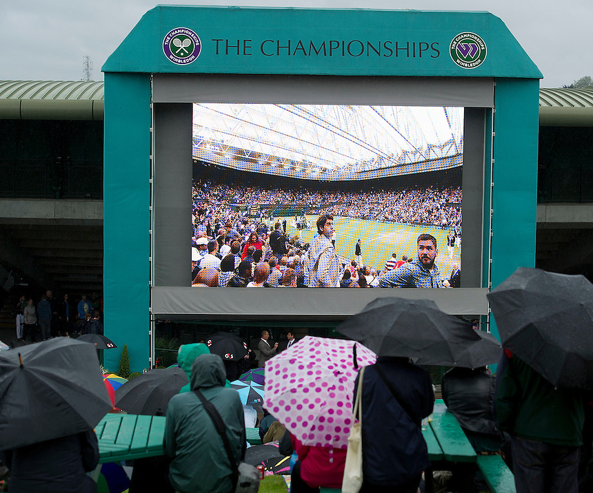 Tennis fans on Henman Hill watch proceedings on the big screeen..Tennis - Wimbledon Lawn Tennis Championships - Day 7 - Monday 2nd July 2012 -  All England Lawn Tennis and Croquet Club - Wimbledon - London - England...