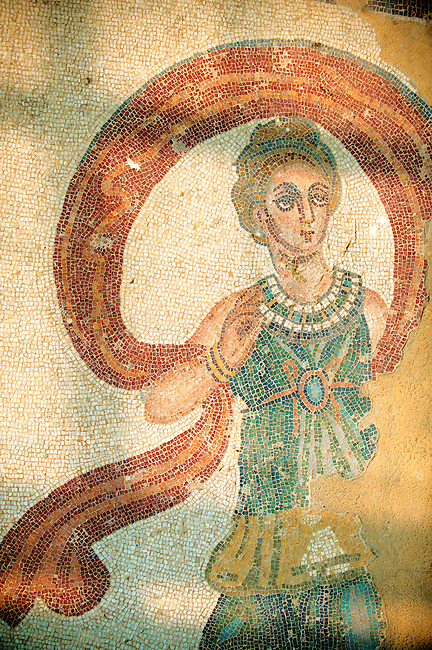 Dancer mosaic from the dance room no 20 - Roman mosaics at the Villa Romana del Casale which containis the richest, largest and most complex collection of Roman mosaics in the world. Constructed  in the first quarter of the 4th century AD. Sicily, Italy. A UNESCO World Heritage Site.