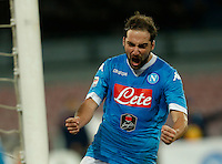 Napoli's Gonzalo Higuain celebrates  during the  italian serie a soccer match,between SSC Napoli and Torino      at  the San  Paolo   stadium in Naples  Italy , January 07, 2016
