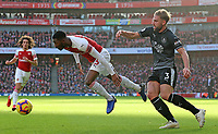 Arsenal's Ainsley Maitland-Niles goes down under a challenge from Burnley's Charlie Taylor<br /> <br /> Photographer David Shipman/CameraSport<br /> <br /> The Premier League - Arsenal v Burnley - Saturday 22nd December 2018 - The Emirates - London<br /> <br /> World Copyright © 2018 CameraSport. All rights reserved. 43 Linden Ave. Countesthorpe. Leicester. England. LE8 5PG - Tel: +44 (0) 116 277 4147 - admin@camerasport.com - www.camerasport.com