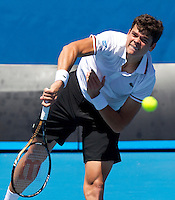 MILOS RAONIC (CAN) against PHILIPP PETZSCHNER (GER) in the second round of the Men's Singles. Milos Raonic beat Philipp Petzschner 6-4 5-7 6-2 7-5  ..19/01/2012, 19th January 2012, 19.01.2012..The Australian Open, Melbourne Park, Melbourne,Victoria, Australia.@AMN IMAGES, Frey, Advantage Media Network, 30, Cleveland Street, London, W1T 4JD .Tel - +44 208 947 0100..email - mfrey@advantagemedianet.com..www.amnimages.photoshelter.com.