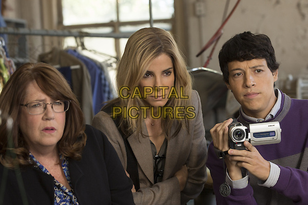 (L-r) ANN DOWD as Nell, SANDRA BULLOCK as Jane and REYNALDO PACHECO as Eddie in Warner Bros. Pictures and Participant Media's satirical comedy &quot;OUR BRAND IS CRISIS,&quot; a Warner Bros. Pictures release.<br /> *Filmstill - Editorial Use Only*<br /> CAP/KFS<br /> Image supplied by Capital Pictures