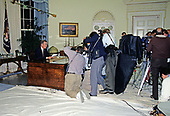 United States President George H.W. Bush poses for photographers after making an address to the nation on the civil disturbances in Los Angeles, California following the Rodney King verdict from the Oval Office of the White House in Washington, DC on May 1, 1992.<br /> Credit: Arnie Sachs  / CNP